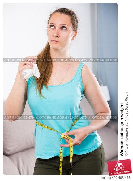 Купить «Woman sad to gain weight», фото № 29405475, снято 21 марта 2017 г. (c) Яков Филимонов / Фотобанк Лори