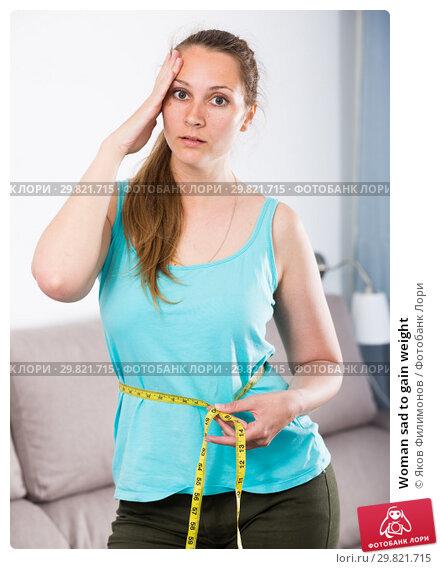 Купить «Woman sad to gain weight», фото № 29821715, снято 21 марта 2017 г. (c) Яков Филимонов / Фотобанк Лори