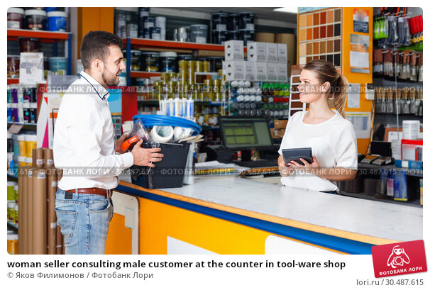 Купить «woman seller consulting male customer at the counter in tool-ware shop», фото № 30487615, снято 17 мая 2018 г. (c) Яков Филимонов / Фотобанк Лори