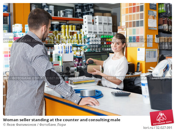 Купить «Woman seller standing at the counter and consulting male», фото № 32027091, снято 17 мая 2018 г. (c) Яков Филимонов / Фотобанк Лори