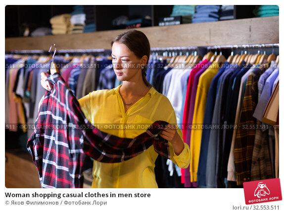 Купить «Woman shopping casual clothes in men store», фото № 32553511, снято 10 декабря 2019 г. (c) Яков Филимонов / Фотобанк Лори