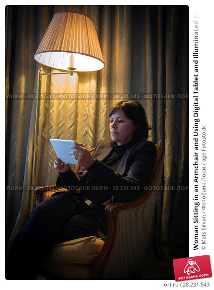 Купить «Woman Sitting in an Armchair and Using Digital Tablet and Illuminated From a Floor Lamp in Cannes In Provence-Alpes-Côte d'Azur, France», фото № 28231543, снято 24 апреля 2019 г. (c) age Fotostock / Фотобанк Лори