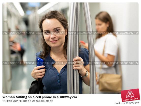 Woman talking on a cell phone in a subway car. Стоковое фото, фотограф Яков Филимонов / Фотобанк Лори