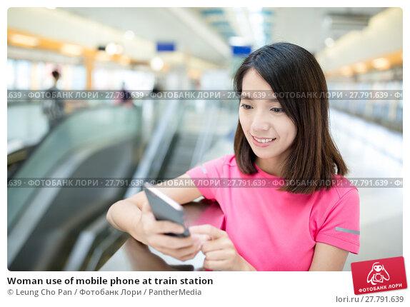 Купить «Woman use of mobile phone at train station», фото № 27791639, снято 19 октября 2018 г. (c) PantherMedia / Фотобанк Лори
