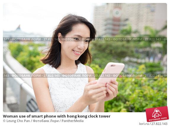 Купить «Woman use of smart phone with hong kong clock tower», фото № 27822143, снято 22 октября 2018 г. (c) PantherMedia / Фотобанк Лори