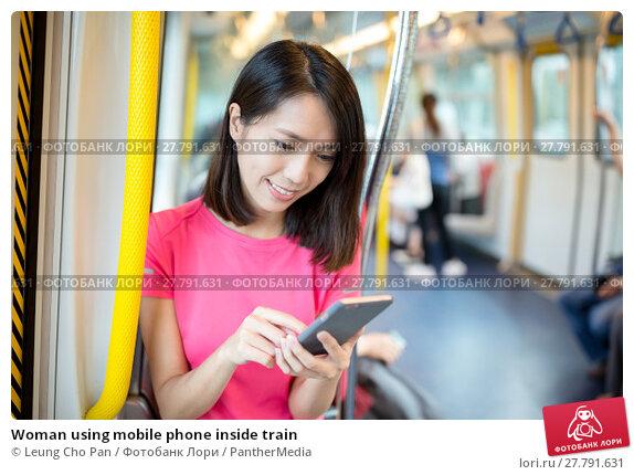 Купить «Woman using mobile phone inside train», фото № 27791631, снято 18 февраля 2018 г. (c) PantherMedia / Фотобанк Лори