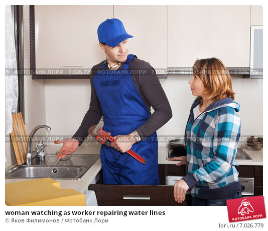 Купить «woman watching as worker repairing water lines», фото № 7026779, снято 1 февраля 2014 г. (c) Яков Филимонов / Фотобанк Лори