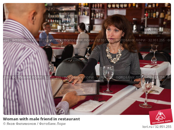 Woman with male friend in restaurant. Стоковое фото, фотограф Яков Филимонов / Фотобанк Лори
