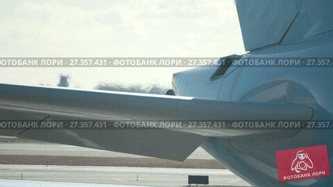 Купить «Working jet engine in International Airport in front of runway», видеоролик № 27357431, снято 10 июня 2019 г. (c) Константин Шишкин / Фотобанк Лори