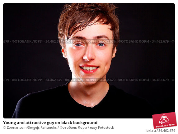 Young and attractive guy on black background. Стоковое фото, фотограф Zoonar.com/Sergejs Rahunoks / easy Fotostock / Фотобанк Лори
