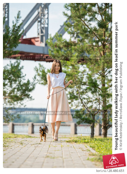 Купить «Young beautiful lady walking with her dog on lead in summer park», фото № 28480651, снято 19 июля 2014 г. (c) Ingram Publishing / Фотобанк Лори