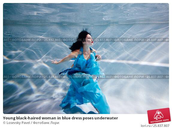 Купить «Young black-haired woman in blue dress poses underwater», фото № 25837807, снято 14 мая 2016 г. (c) Losevsky Pavel / Фотобанк Лори
