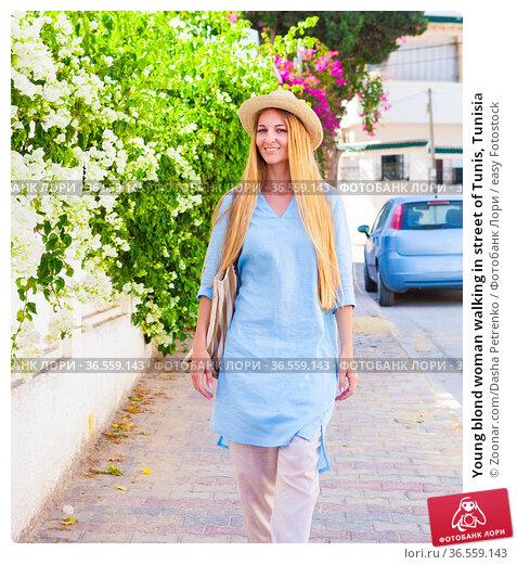 Young blond woman walking in street of Tunis, Tunisia. Стоковое фото, фотограф Zoonar.com/Dasha Petrenko / easy Fotostock / Фотобанк Лори