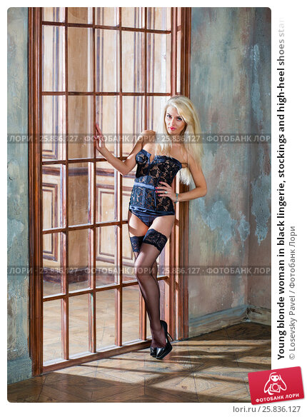 Купить «Young blonde woman in black lingerie, stockings and high-heel shoes stands near lattice door in room with ragged walls», фото № 25836127, снято 17 сентября 2015 г. (c) Losevsky Pavel / Фотобанк Лори