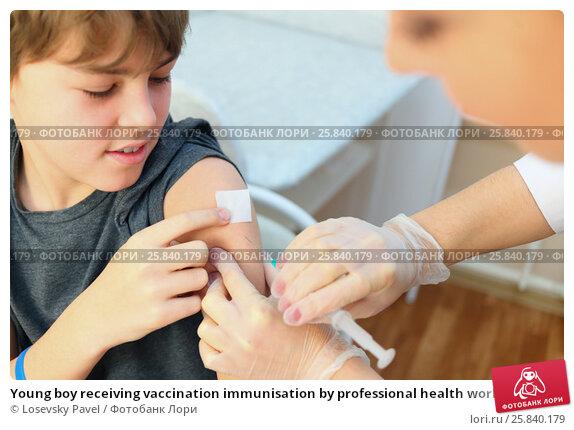 Купить «Young boy receiving vaccination immunisation by professional health worker, focus on shoulder», фото № 25840179, снято 29 ноября 2014 г. (c) Losevsky Pavel / Фотобанк Лори