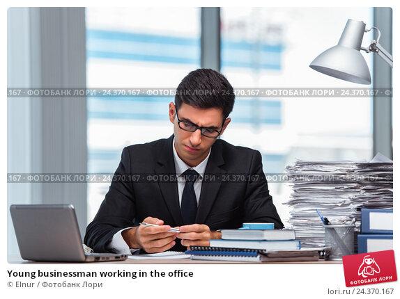 Купить «Young businessman working in the office», фото № 24370167, снято 28 июня 2016 г. (c) Elnur / Фотобанк Лори
