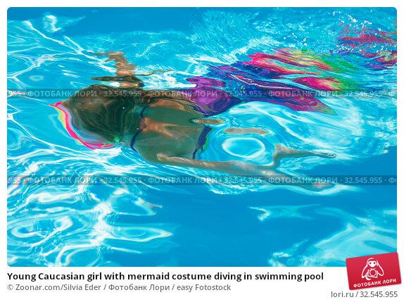 Купить «Young Caucasian girl with mermaid costume diving in swimming pool», фото № 32545955, снято 7 декабря 2019 г. (c) easy Fotostock / Фотобанк Лори