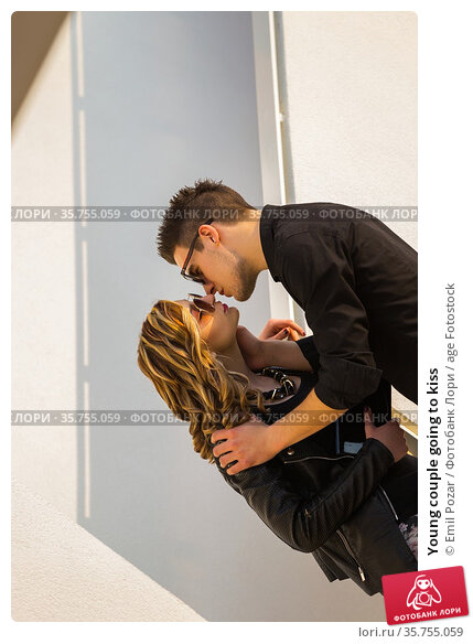 Young couple going to kiss. Стоковое фото, фотограф Emil Pozar / age Fotostock / Фотобанк Лори