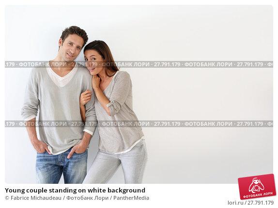 Купить «Young couple standing on white background», фото № 27791179, снято 21 февраля 2018 г. (c) PantherMedia / Фотобанк Лори