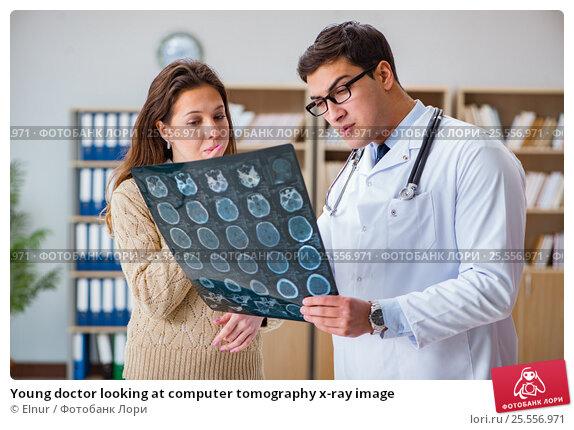 Купить «Young doctor looking at computer tomography x-ray image», фото № 25556971, снято 8 декабря 2016 г. (c) Elnur / Фотобанк Лори