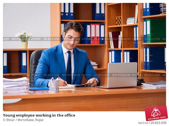 Купить «Young employee working in the office», фото № 29823039, снято 9 августа 2018 г. (c) Elnur / Фотобанк Лори
