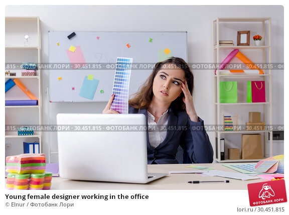 Young female designer working in the office. Стоковое фото, фотограф Elnur / Фотобанк Лори