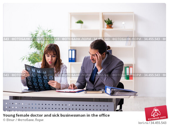 Young female doctor and sick businessman in the office. Стоковое фото, фотограф Elnur / Фотобанк Лори