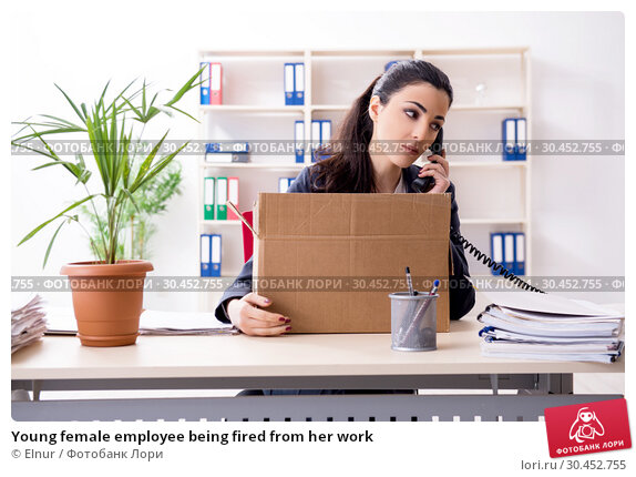 Young female employee being fired from her work. Стоковое фото, фотограф Elnur / Фотобанк Лори