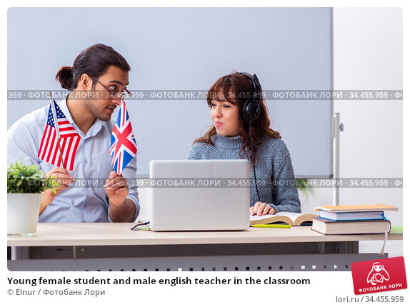 Young female student and male english teacher in the classroom. Стоковое фото, фотограф Elnur / Фотобанк Лори