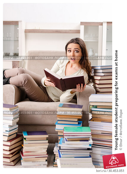 Young female student preparing for exams at home. Стоковое фото, фотограф Elnur / Фотобанк Лори