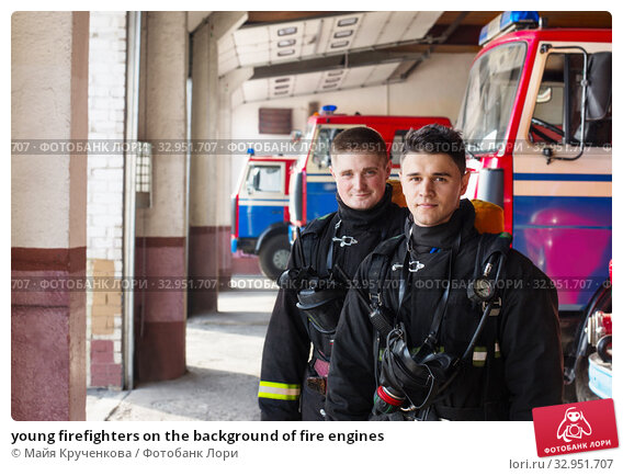 young firefighters on the background of fire engines. Стоковое фото, фотограф Майя Крученкова / Фотобанк Лори