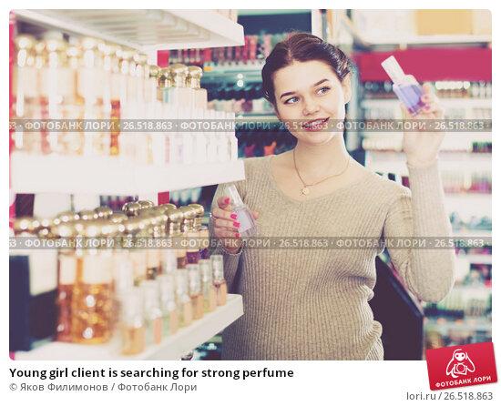 Купить «Young girl client is searching for strong perfume», фото № 26518863, снято 21 февраля 2017 г. (c) Яков Филимонов / Фотобанк Лори