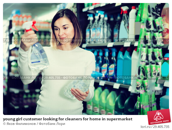 Купить «young girl customer looking for cleaners for home in supermarket», фото № 29405735, снято 23 ноября 2016 г. (c) Яков Филимонов / Фотобанк Лори