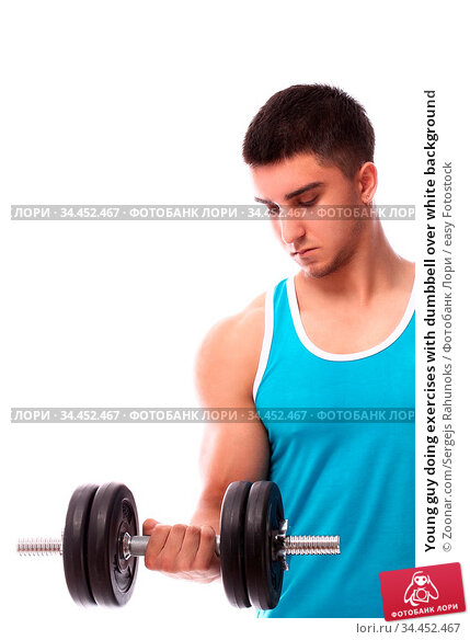 Young guy doing exercises with dumbbell over white background. Стоковое фото, фотограф Zoonar.com/Sergejs Rahunoks / easy Fotostock / Фотобанк Лори