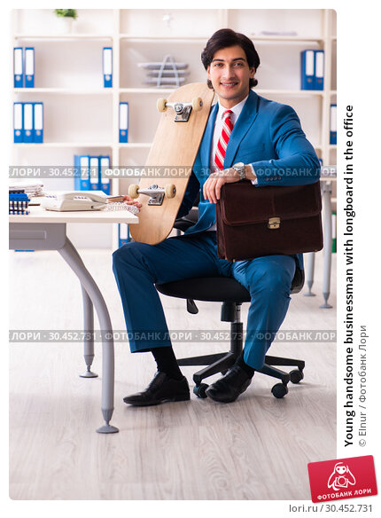 Young handsome businessman with longboard in the office. Стоковое фото, фотограф Elnur / Фотобанк Лори