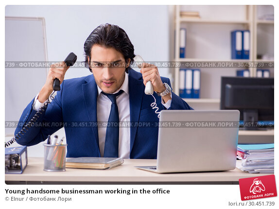 Young handsome businessman working in the office. Стоковое фото, фотограф Elnur / Фотобанк Лори