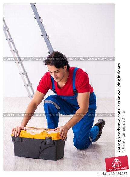 Young handsome contractor working indoors. Стоковое фото, фотограф Elnur / Фотобанк Лори