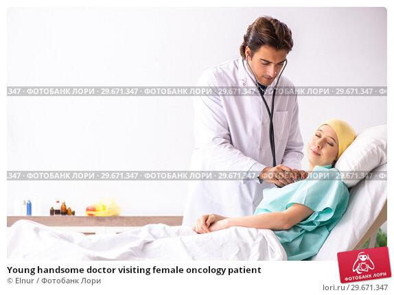 Купить «Young handsome doctor visiting female oncology patient», фото № 29671347, снято 3 октября 2018 г. (c) Elnur / Фотобанк Лори