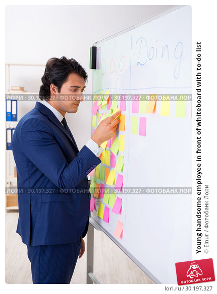 Купить «Young handsome employee in front of whiteboard with to-do list», фото № 30197327, снято 16 октября 2018 г. (c) Elnur / Фотобанк Лори