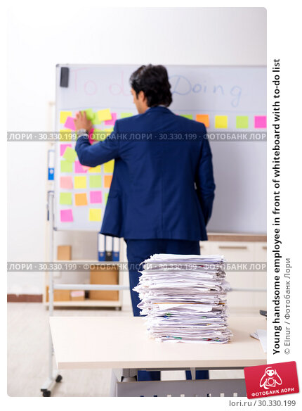 Купить «Young handsome employee in front of whiteboard with to-do list», фото № 30330199, снято 16 октября 2018 г. (c) Elnur / Фотобанк Лори