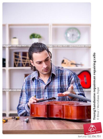 Купить «Young handsome repairman repairing cello», фото № 32356751, снято 4 апреля 2019 г. (c) Elnur / Фотобанк Лори