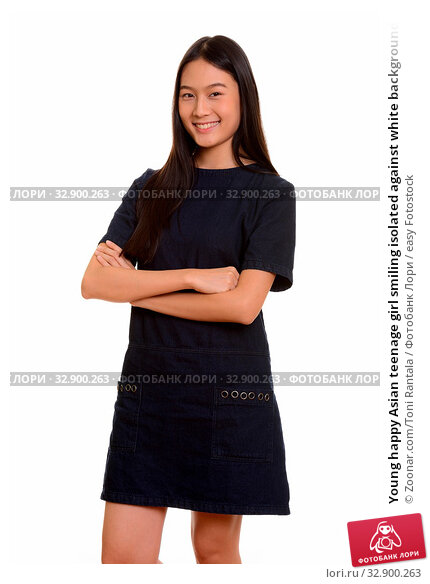 Young happy Asian teenage girl smiling isolated against white background. Стоковое фото, фотограф Zoonar.com/Toni Rantala / easy Fotostock / Фотобанк Лори