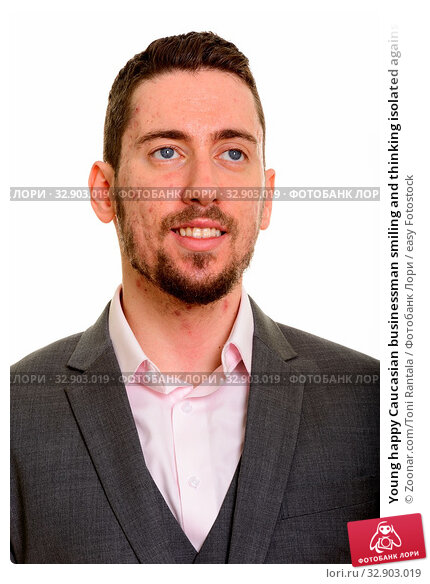 Young happy Caucasian businessman smiling and thinking isolated against white background. Стоковое фото, фотограф Zoonar.com/Toni Rantala / easy Fotostock / Фотобанк Лори