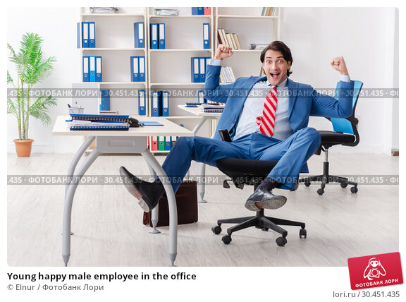 Young happy male employee in the office. Стоковое фото, фотограф Elnur / Фотобанк Лори