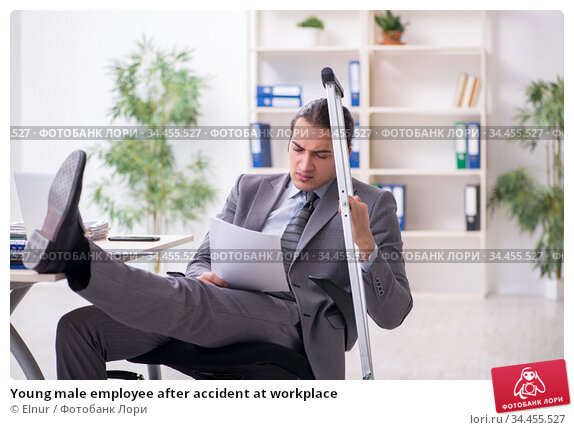Young male employee after accident at workplace. Стоковое фото, фотограф Elnur / Фотобанк Лори