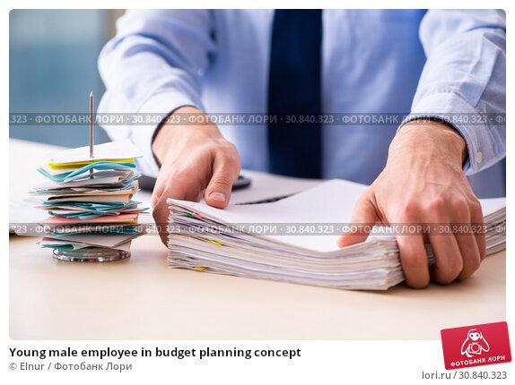 Купить «Young male employee in budget planning concept», фото № 30840323, снято 17 декабря 2018 г. (c) Elnur / Фотобанк Лори