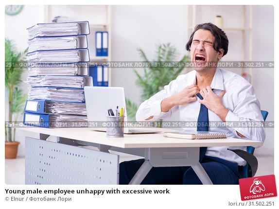 Купить «Young male employee unhappy with excessive work», фото № 31502251, снято 5 марта 2019 г. (c) Elnur / Фотобанк Лори