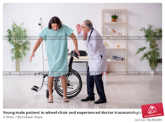 Young male patient in wheel-chair and experienced doctor traumatologist. Стоковое фото, фотограф Elnur / Фотобанк Лори