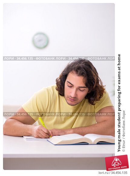 Young male student preparing for exams at home. Стоковое фото, фотограф Elnur / Фотобанк Лори