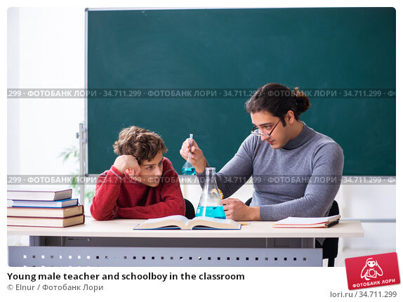 Young male teacher and schoolboy in the classroom. Стоковое фото, фотограф Elnur / Фотобанк Лори